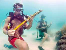 """Lower Keys Underwater Music Festival -- July 13, Big Pine Key, Fla. -- Now in its 29th year, hundreds of aquatic aficionados show up to dive and rock out under the waves at this submerged songfest. Staged by a local radio station, music is broadcast into the ocean from Lubell Laboratory speakers suspended beneath boats. With """"Salute to the Rolling Stone Crabs"""" as the theme, divers dressed in the likes of """"Mick Jawfish"""" and """"Keith Pilchard"""" dip under the water to perform hits including """"HonkyConch Woman"""" and other marine melodies such as the Beatles' """"Yellow Submarine."""" There is no associated dive-fee for the event."""