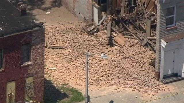 Baltimore City fire officials said the partial collapse occurred around 12:20 p.m. in the 1800 block of North Collington Avenue at a vacant, boarded-up building.