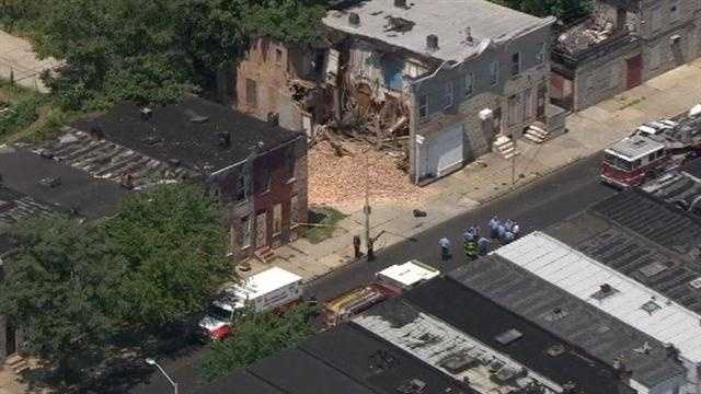 The side of the structure collapsed into an adjoining alley.