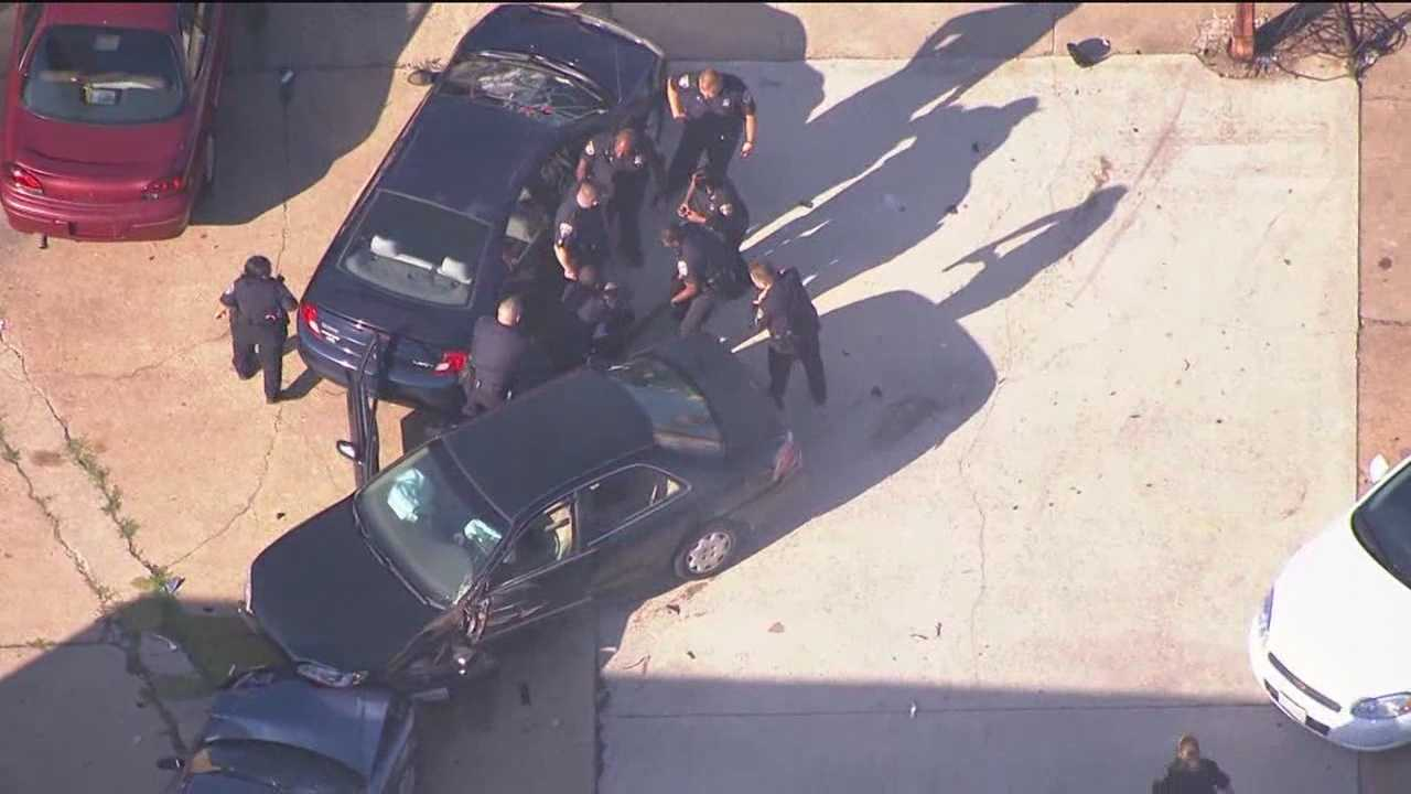 A police pursuit caught on camera by SkyTeam 11 ends with a crash and leads to the suspension of an officer.