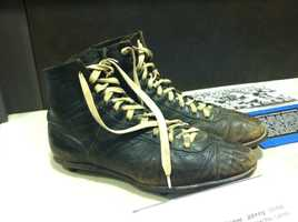 A pair of Johnny Unitas' iconic hightop cleats on display.