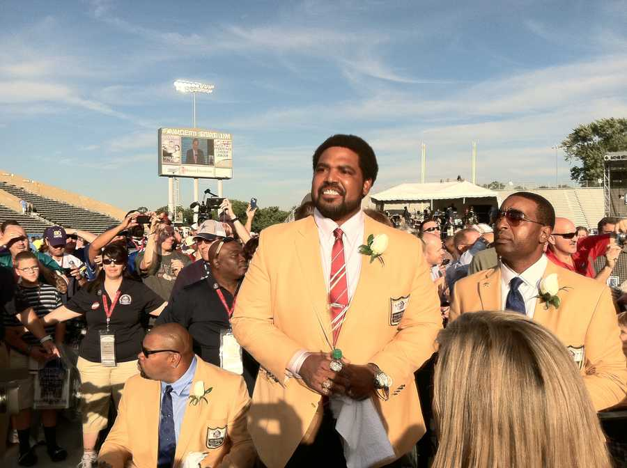 Jonathan Ogden and Cris Carter get ready to rake the stage for the Hall of Fame enshrinement ceremony at Fawcett Stadium in Canton, Ohio.