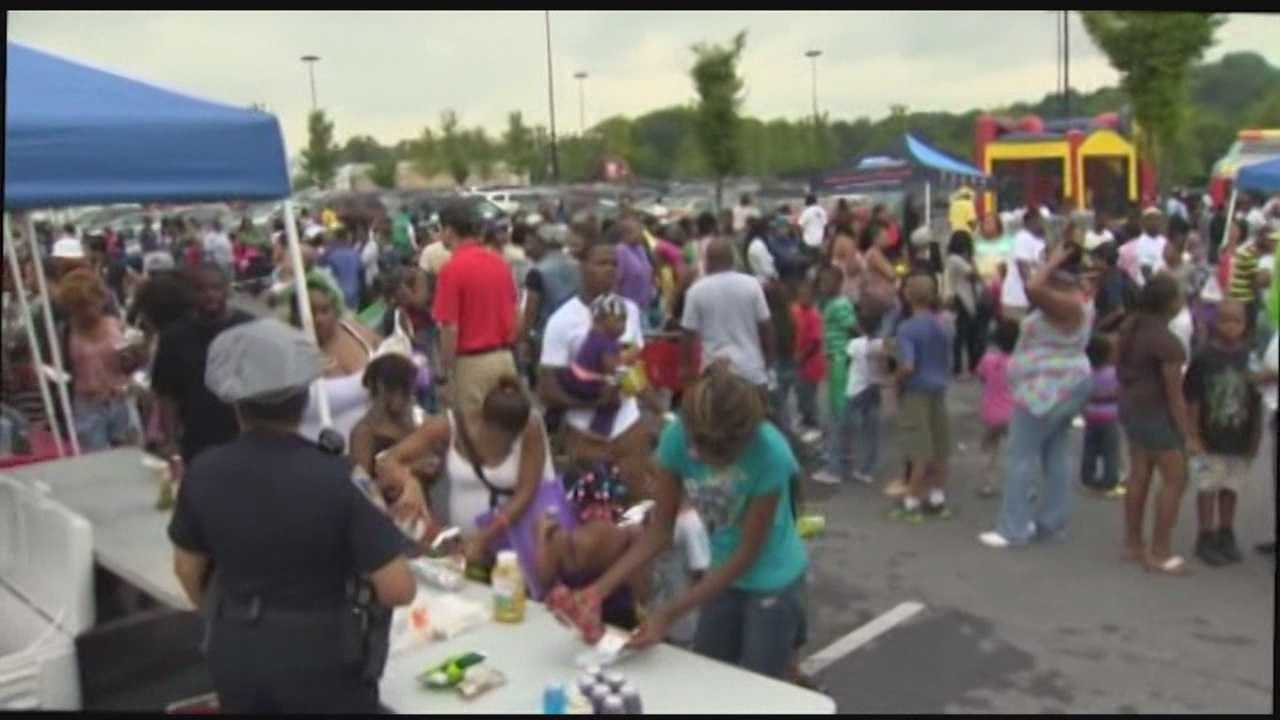 Thousands attend a National Night Out event at Mondawmin Mall in Baltimore.