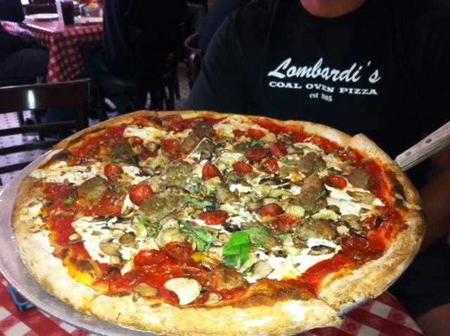 4. New York City -- Travelers to New York City craving authentic, thin crust pizza will be in their glory as they bite into a scrumptious slice at one of New York's famed pizzerias which include Lombardi's, Di Fara's, and Patsy's.