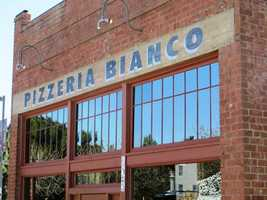 """10. Phoenix, Ariz. -- Even in the desert travelers can enjoy a piece of the pie. Those visiting the """"Valley of the Sun"""" will find scrumptious slices of airy, bubbling crust and savory cheese, paired with the perfect amount of fresh tomato sauce."""