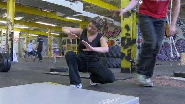 Kim Dacey tries the movement art called Parkour at a new studio in Baltimore.