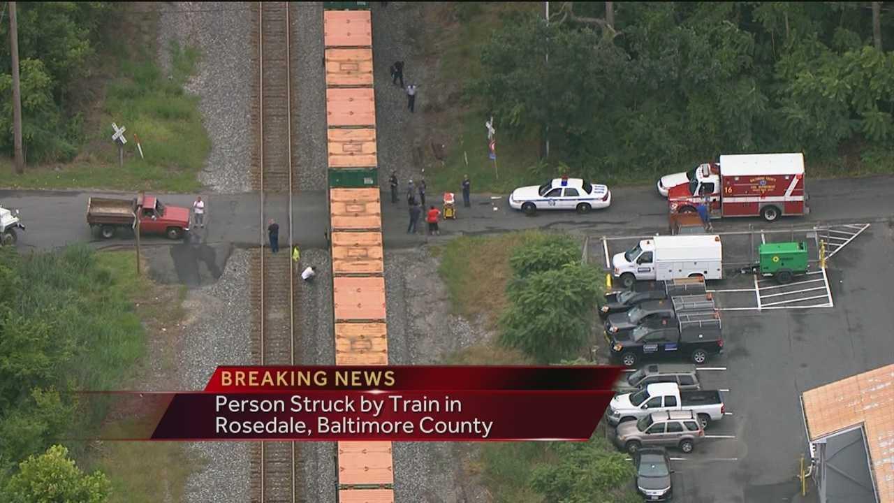 Woman struck by train in Rosedale photo