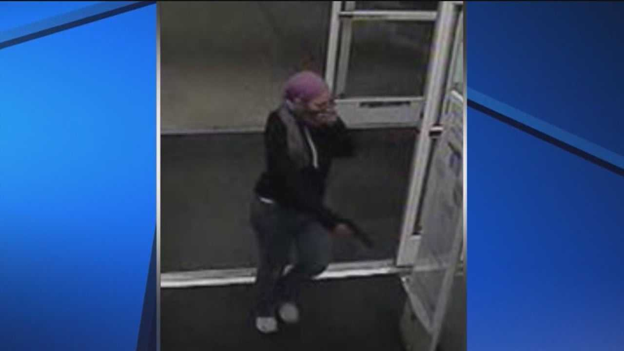 Anne Arundel County detectives say this woman, donning a purple scarf, robbed a Royal Farms on Oak Manor Drive in Glen Burnie, just minutes after a failed attempt at a nearby Rite Aid pharmacy on Aug. 24.