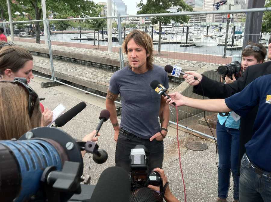 Keith Urban talks to reporters before the big kickoff concert.
