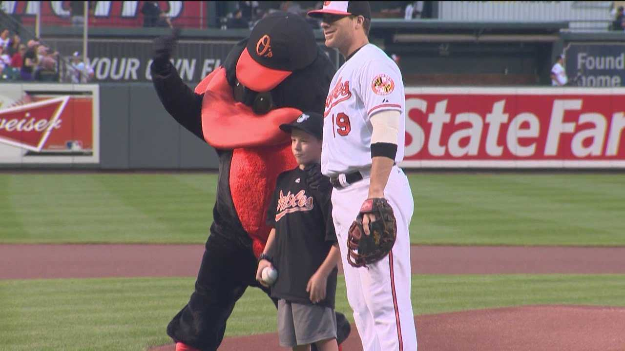 Brandon Schneider throws out the first pitch at Thursday night's Orioles game.