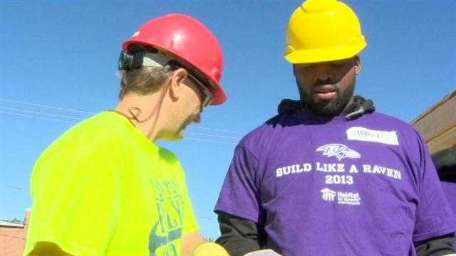 Ravens wide receiver Torrey Smith looks at the plans with a Habitat for Humanity builder.