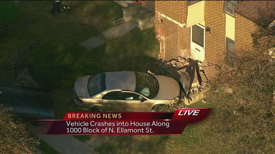A car crashes into an apartment building in west Baltimore around 5 p.m. Monday.