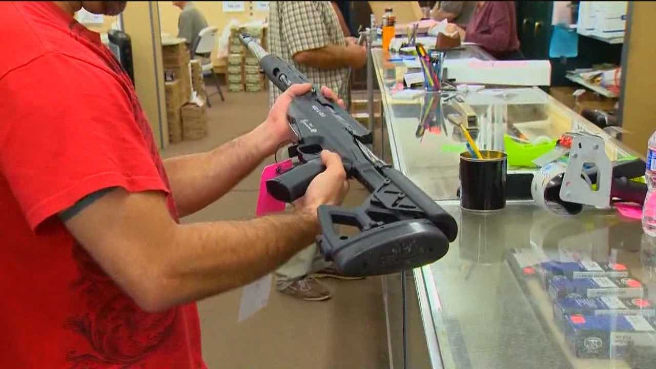 Opposing groups duel over state's new gun control laws
