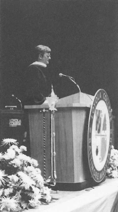 A photo of Mr. Clancy delivering Loyola's 1986 commencement address.