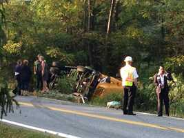 Baltimore County police investigate an overturned school bus that injured some students.