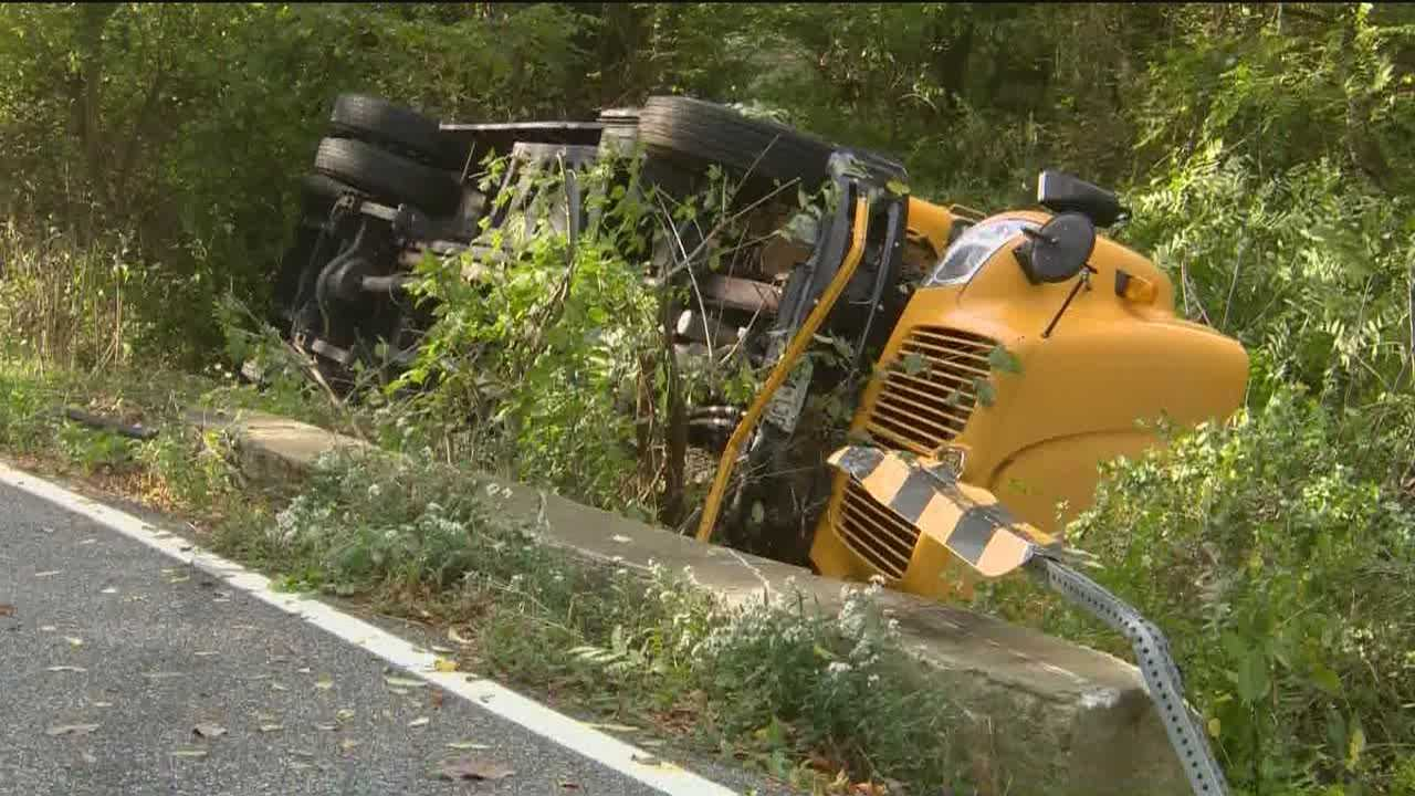 Police said six people were injured after a school bus heading to Pikesville Middle School overturned Friday morning in Baltimore County.
