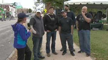 Jennifer Franciotti talks to one of 11 bands playing at the event. Outbreak is a local band that's been together for about 5 years.