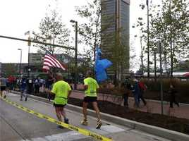 These runners are carrying flags in remembrance of Sept. 11, 2001.