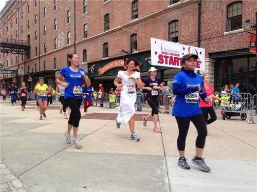 The runner in the white dress running the 5K was also getting married the same day!
