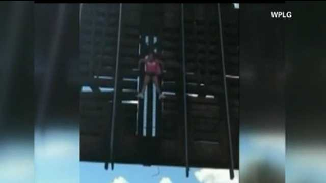 Woman dangling from drawbridge rescued