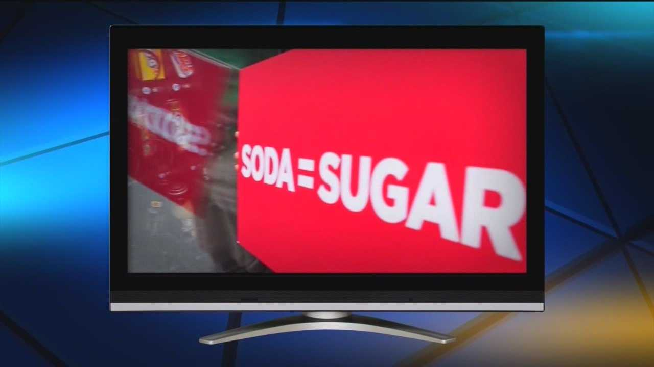A new ad campaign designed to show kids there are healthier options to drink also takes a few swipes at the Coca-Cola Co.