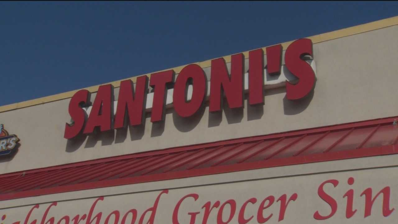 A district court notice was taped to the front door of Santoni's Supermarket citing failure to pay rent.