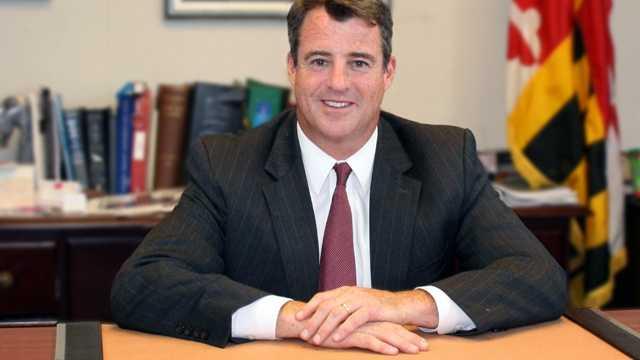 Doug Gansler at desk