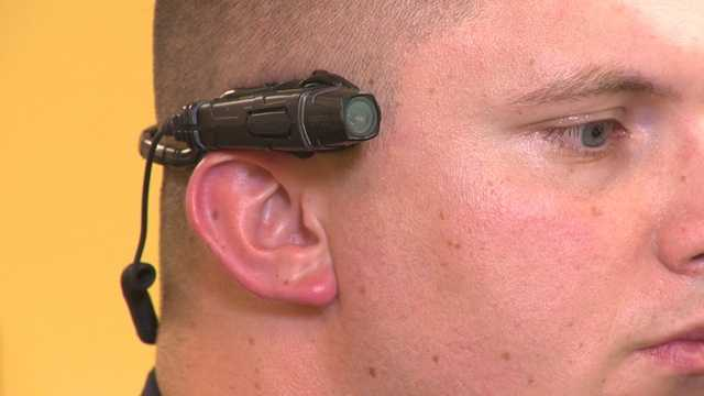 It comes from a tiny battery-operated camera magnetically mounted on the glasses of a Laurel police officer.