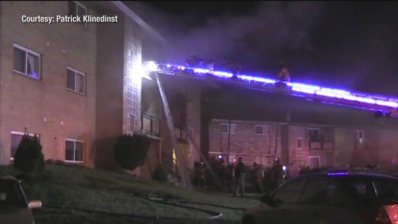 A two-alarm fire displaces 18 people in Dundalk and injures three people, including a firefighter.