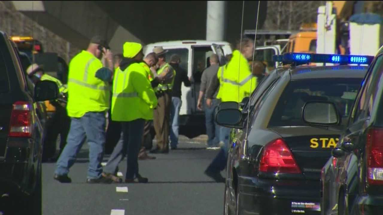 One State Highway Administration worker was killed and a second was injured when a car smashed into them while they were working on a roadway sign on the Beltway, Maryland State Police said. The driver of the car was also injured.