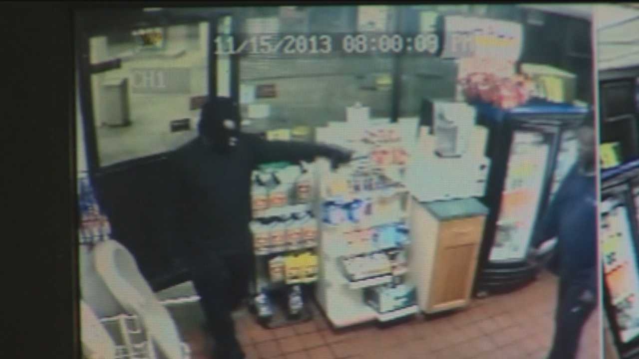 Surveillance video shows one of three robberies in Anne Arundel County Friday night.