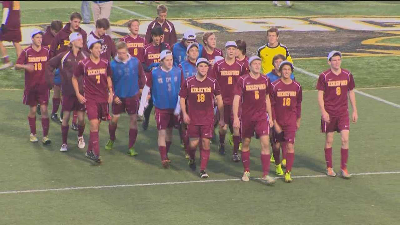The Hereford High School varsity soccer team walks off the field after winning the 2013 state championship.