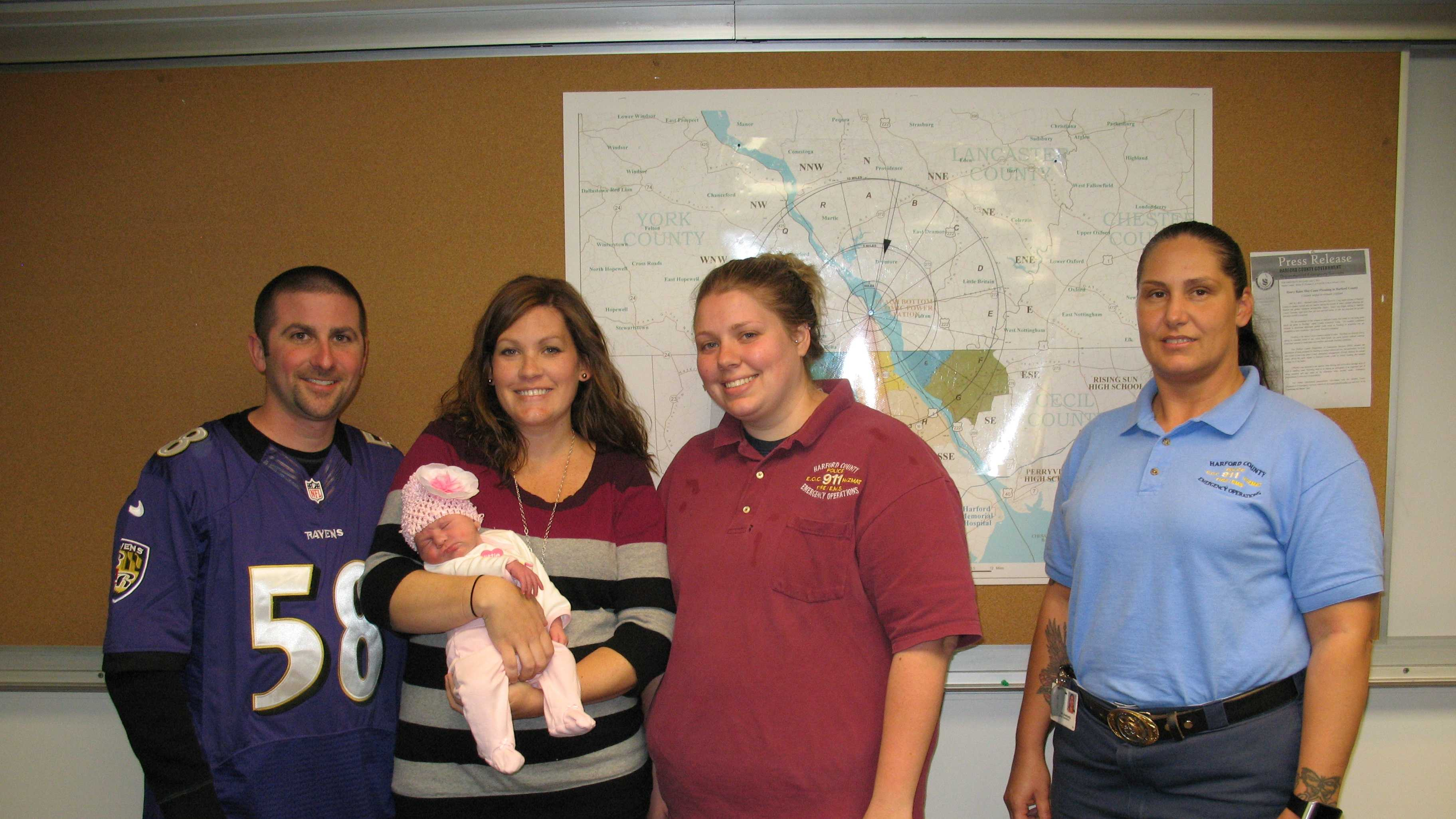 Matt and Emily Kulaga and their new daughter, Aubree Mae, meet Harford County public safety dispatchers Christina Abrams and Amanda Dolehanty.