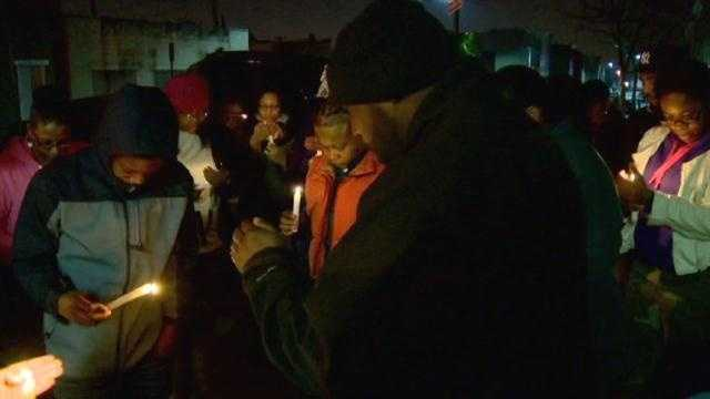 Friends and family hold a vigil on the third anniversary of Raquan Campbell's slaying.