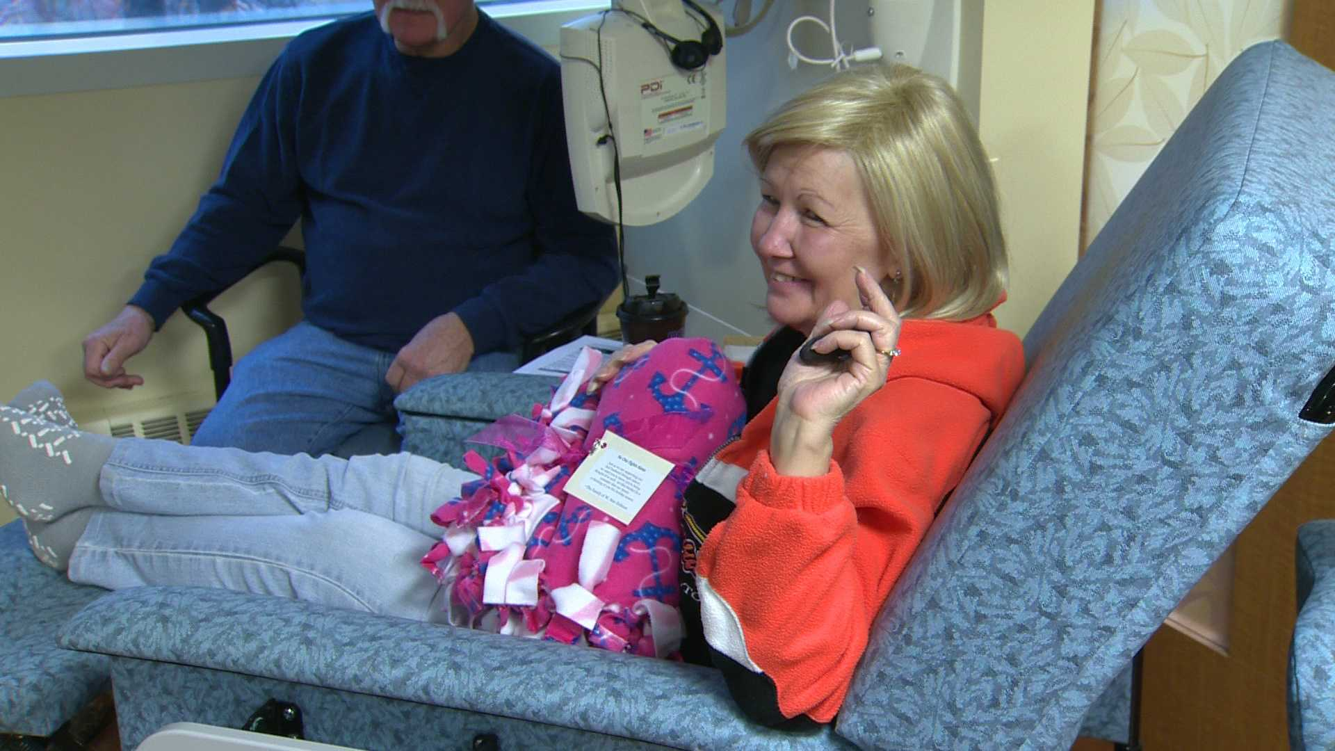 A chemo patient gets her homemade blanket.