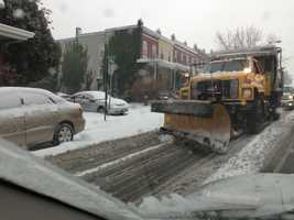 Crews work on the roads near Cold Spring Lane on Sunday.
