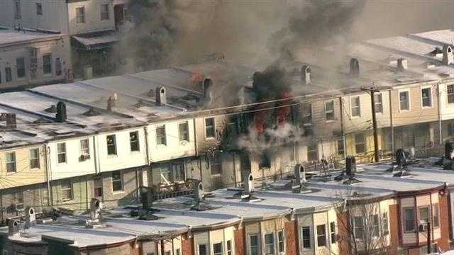 Several homes caught fire in the 600 block of Oldham Street in east Baltimore on Tuesday.