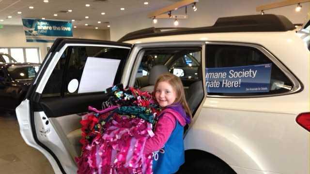 Adalyn Le Boutillier of Troop 10208 donating blankets made by her troop.