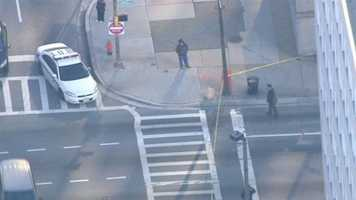 Authorities respond to the federal courthouse in downtown Baltimore to investigate an incident that Sky Team 11 video showed involved a man with a gun.