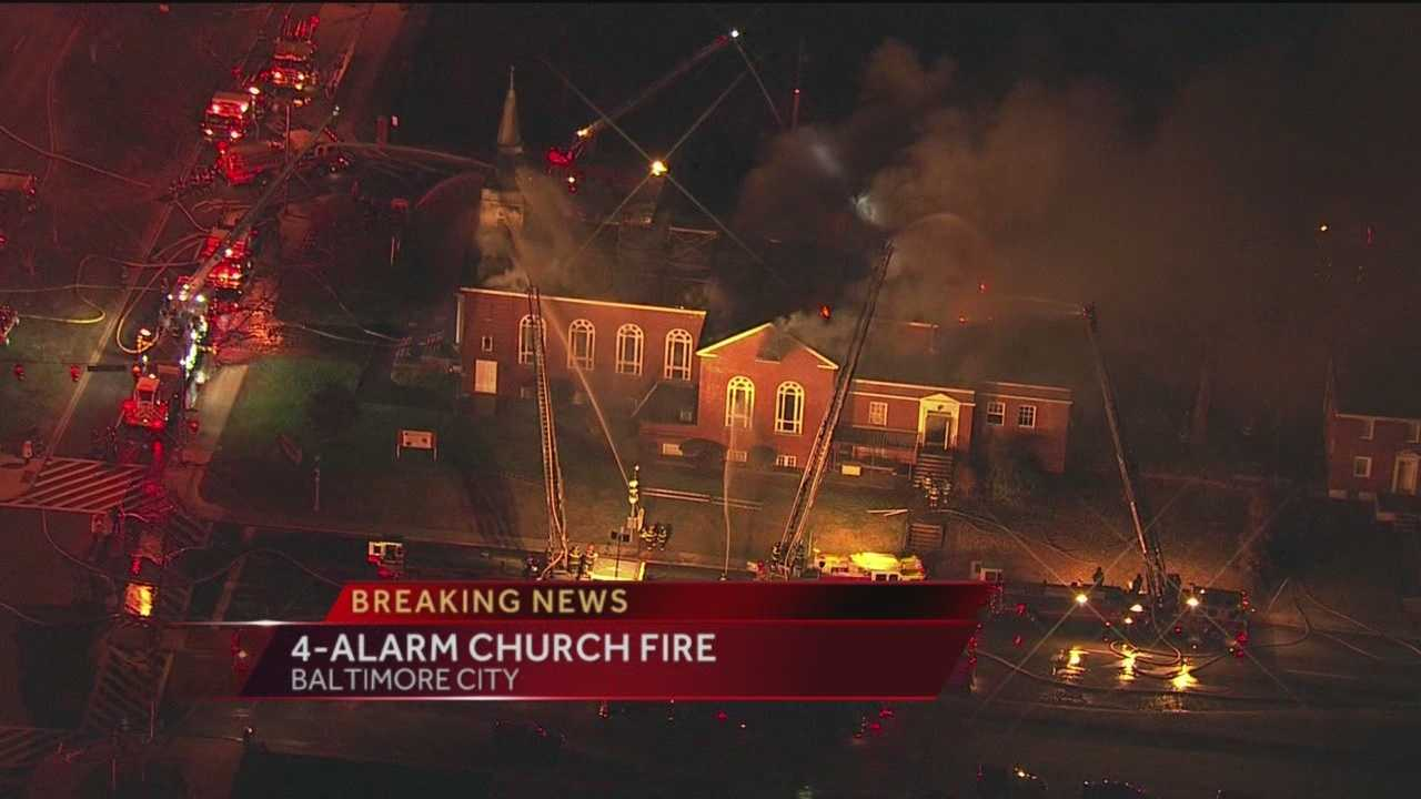 A four-alarm fire severely damages a church and school in Baltimore early Friday morning.