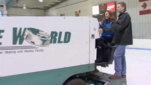 11 News reporter Jennifer Franciotti learns to drive an ice resurfacer at Ice World in Abingdon.
