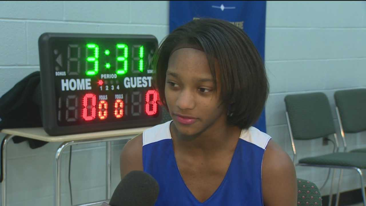 Janya Lilly is a middle-schooler in east Baltimore who is holding court as the co-captain of the boys' basketball team at her school.