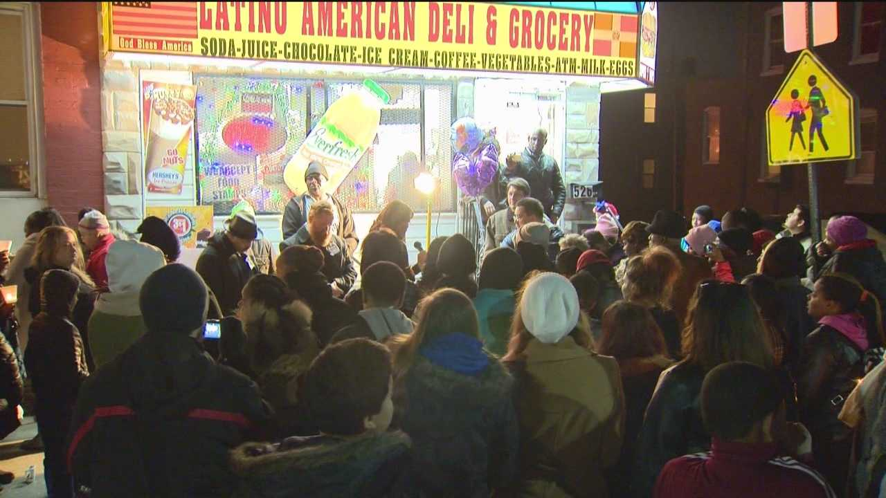 img-Neighbors show support after grocery store slaying
