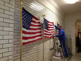 Jan. 21: A state prison inmate steams wrinkles out of flags that will be used for the State of the State address.