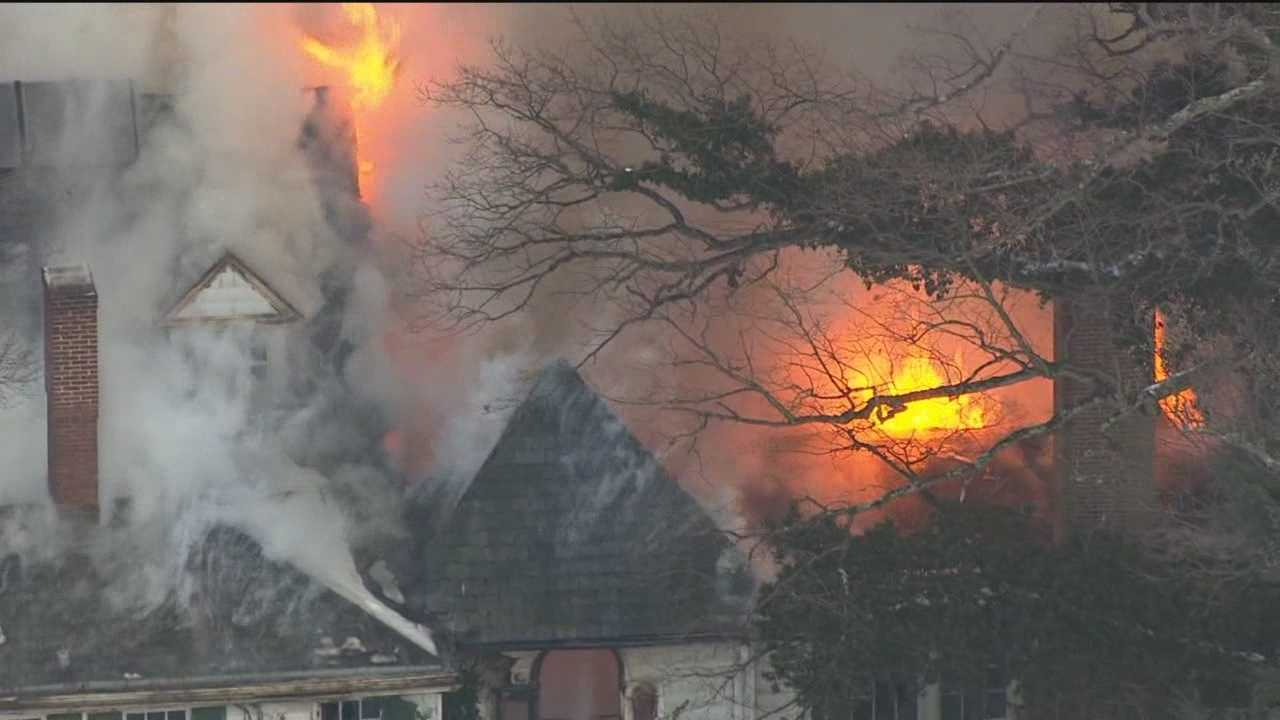 A three-alarm fire spread quickly through a 159-year-old mansion in Baltimore's Roland Park neighborhood Thursday afternoon, destroying the Civil War-era home.