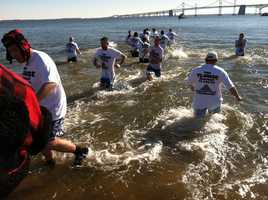 Super plungers head into the frigid waters.