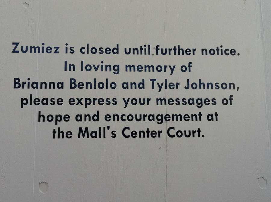 A sign outside the Zumiez store expresses condolences to the families of the victims.