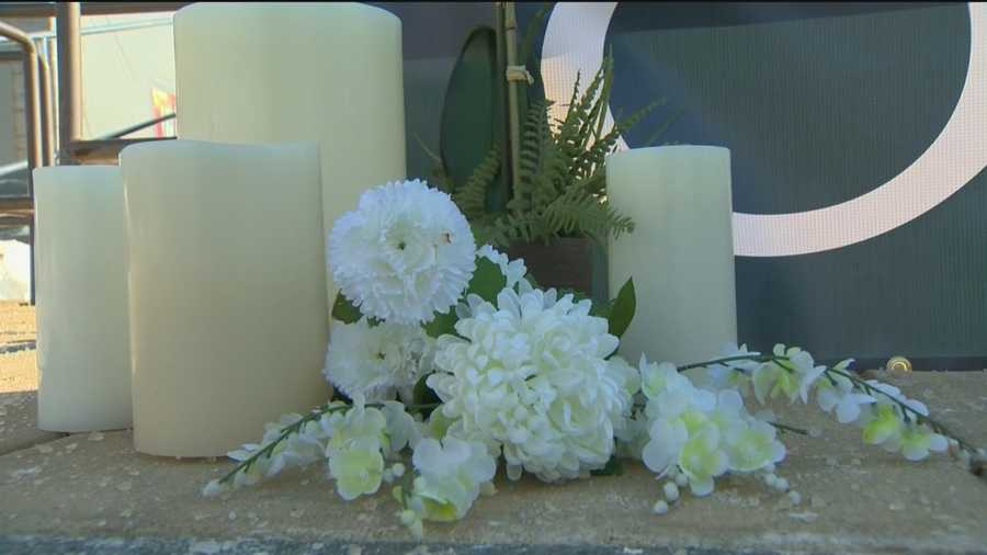 Flowers sit at one of the memorials for the victims of the Columbia Mall shooting.