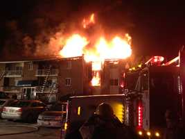 Baltimore County fire crews battle a three-alarm blaze in Pikesville that destroyed several apartments early Thursday morning and injured two people.