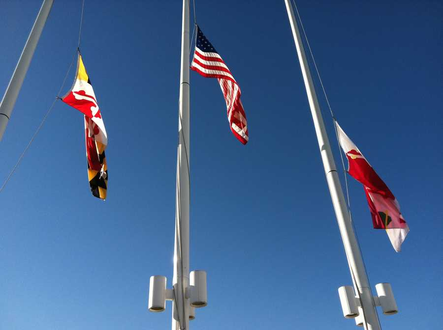 These flag poles are just a few yards from the memorial outside the mall.
